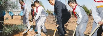 习近平在参加首都义务植树活动时强调 坚持全国动员全民动手植树造林 把建设美丽中国化为人民自觉行动